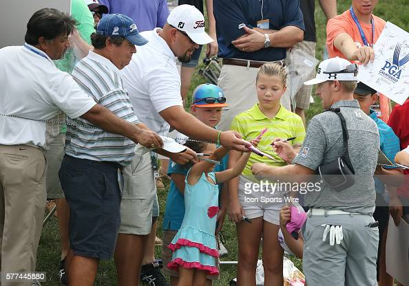 Hunter Mahan signs autographs for fans during a practice round at the PGA Championship at Valhalla Golf Club in Louisville Ky