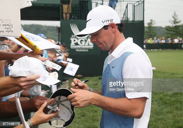 Rory McIlroy signs autographs for fans during a practice round at the PGA Championship at Valhalla Golf Club in Louisville Ky