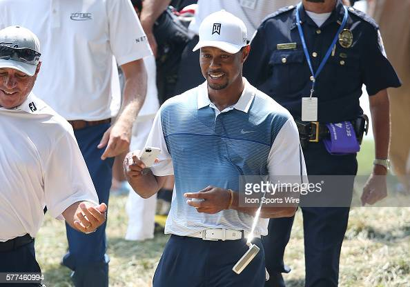Tiger Woods looks at his phone during a practice round at the PGA Championship at Valhalla Golf Club in Louisville Ky