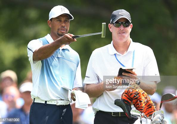 Tiger Woods talks with his caddie Joe LaCava during a practice round at the PGA Championship at Valhalla Golf Club in Louisville Ky