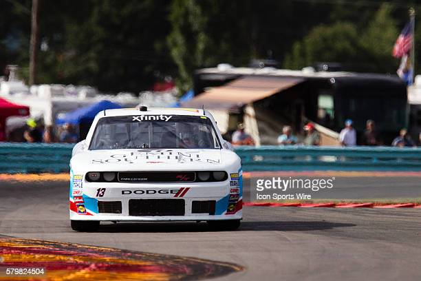 NASCAR XFINITY Series driver Carl Long driver of the Braille Battery / Grafoid Dodge exits the inner loop and races into the carousel during the...