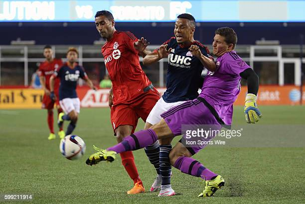 Toronto FC defender Ahmed Kantari and Toronto FC goalkeeper Joe Bendik sandwich New England Revolution forward Charlie Davies The New England...