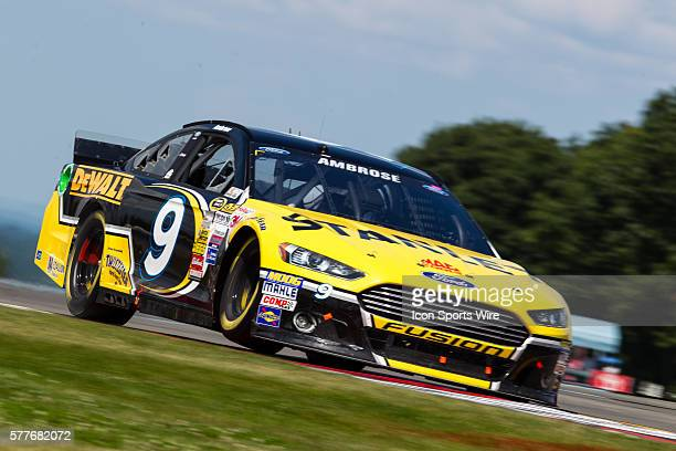 NASCAR Sprint Cup Series driver Marcos Ambrose driver of the Stanley Ford exits the bus stop during the Sprint Cup Series CheezIt 355 at the Glen at...