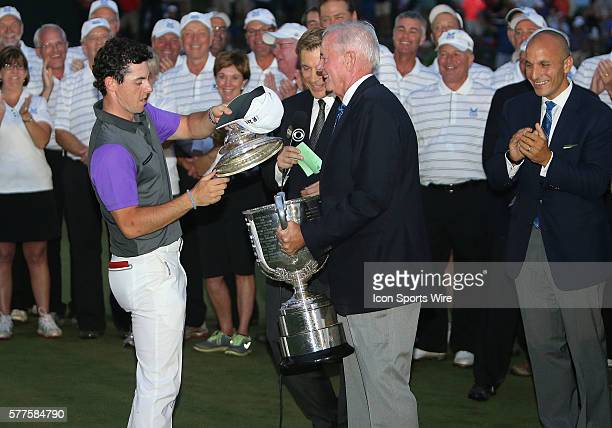 Rory McIlroy and PGA President Ted Bishop nearly drop the Wanamaker Trophy after McIlroy wins the PGA Championship at Valhalla Golf Club in...