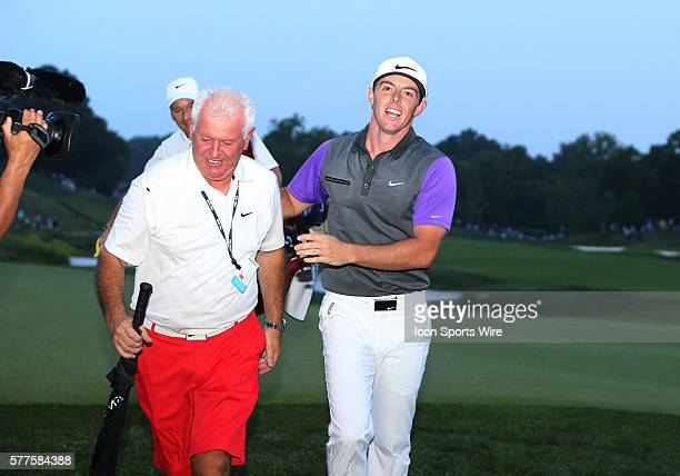 Rory McIlroy celebrates with his father after he wins the PGA Championship at Valhalla Golf Club in Louisville Ky