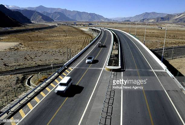 LHASA August 10 2015 Photo taken on August 29 2014 shows the LhasaGonggar Airport highway southwest China's Tibet Autonomous Region People witnessed...