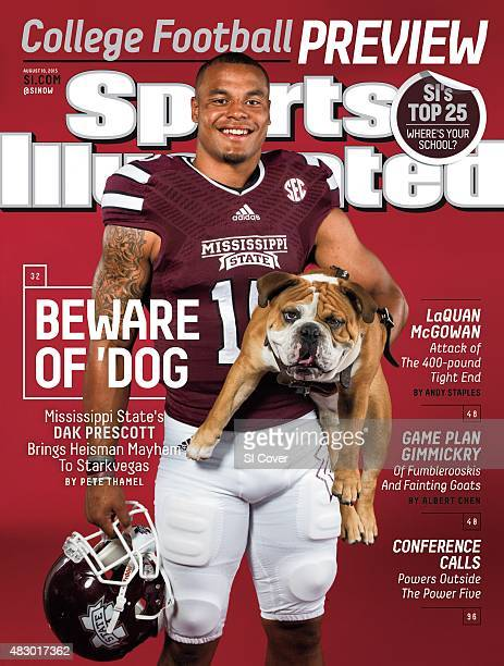 College Football NCAA Season Preview Closeup portrait of Mississippi State QB Dak Prescott posing with mascot Bully the Bulldog during photo shoot on...