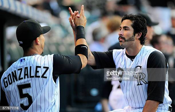 Rockies outfielders Ryan Spilborghs and Carlos Gonzalez show a special handshake in the dugout prior to a regular season game between the Pittsburgh...