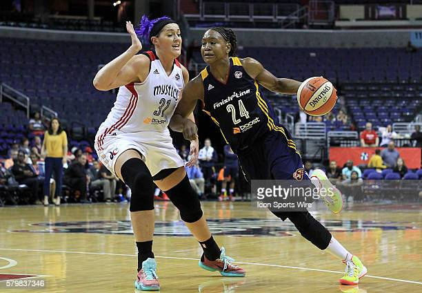 Indiana Fever forward Tamika Catchings bursts past Washington Mystics center Stefanie Dolson during a WNBA game at Verizon Center in Washington DC...