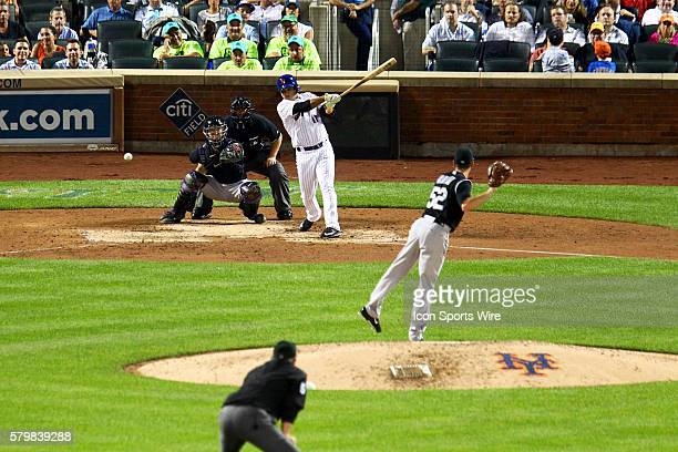 New York Mets Infield Ruben Tejada [8250] hits a RBI single in the 6th inning scoring Michael Cuddyer during a MLB game between the Colorado Rockies...