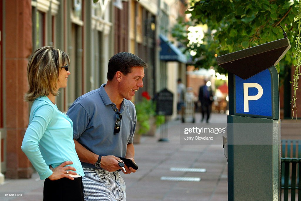 DENVER COLO August 12 2003 Christina Hansen <cq> and Tom Parsley <cq> try to figure out a selfservice parking kiosk along Larimer Street in Downtown...