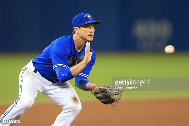 TORONTO ON August 12 Toronto Blue Jays third baseman Darwin Barney fields a ground ball against the Pittsburgh Pirates in the third