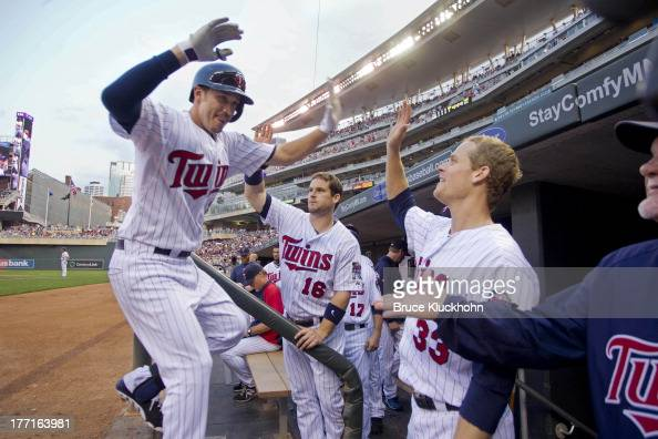 Trevor Plouffe of the Minnesota Twins celebrates his home run against the Cleveland Indians with Josh Willingham and Justin Morneau on August 12 2013...