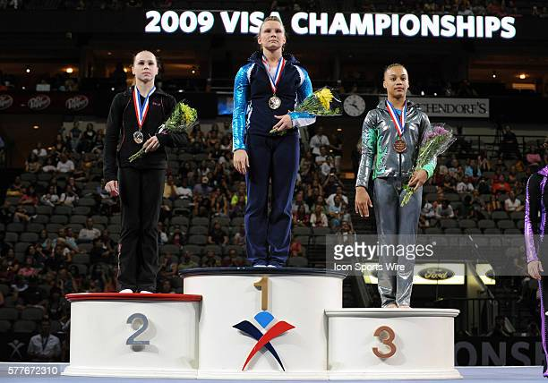 Floor Excercise champions Rebecca Bross in second place Bridget Sloan in first place and Kytra Hunter wave to the crowd at the VISA Championships at...