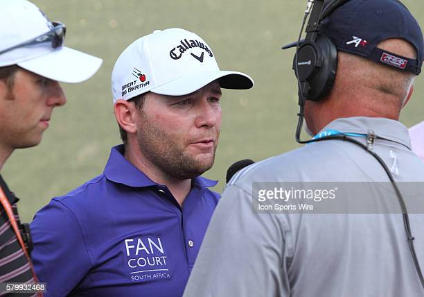 Branden Grace of South Africa answers questions after finishing third with a score of fifteen under par for the PGA Championship at Whistling Straits...