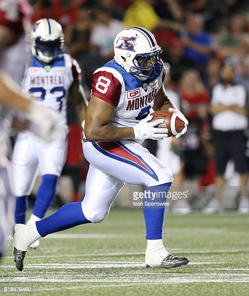 Nik Lewis of the Montreal Alouettes rushing against the Ottawa Redblacks in Canadian Football League action at TD Place Stadium in Ottawa Canada