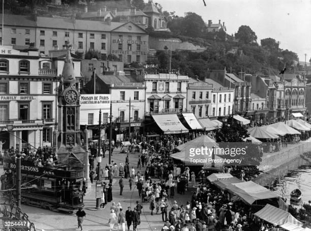 A busy scene in the square at Torquay Devon