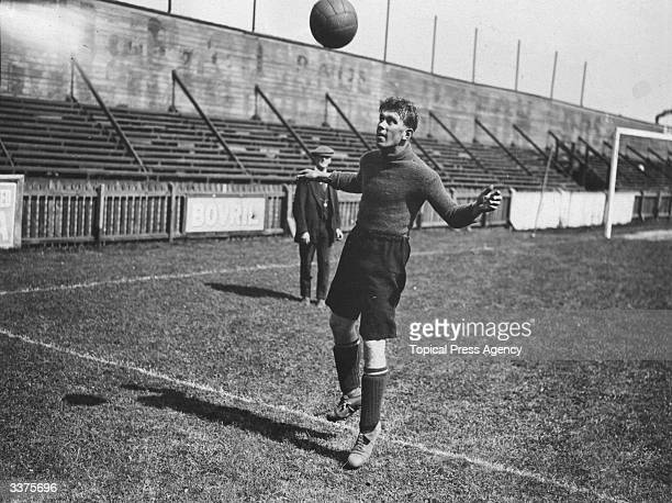 British footballer A Roe of Luton Town practising his heading technique