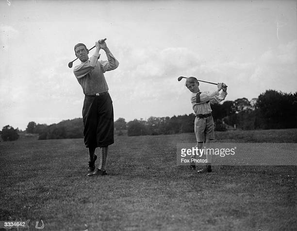 George Duncan winner of the British Open in 1920 on Wentworth golf course giving his young son a few golfing tips