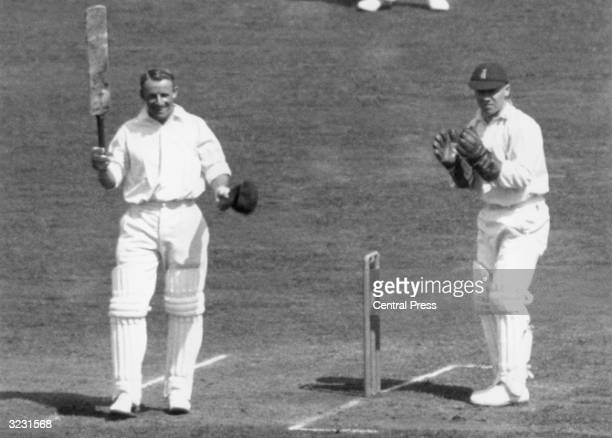 CHECK HIRES IF SUPPLYING DIGITALLY Australian cricketing legend Don Bradman saluting the crowd during his record innings where he made 232 runs...