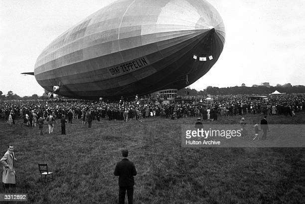 Crowds looking at the Graf Zeppelin the German airship which has landed at Hanworth aerodrome