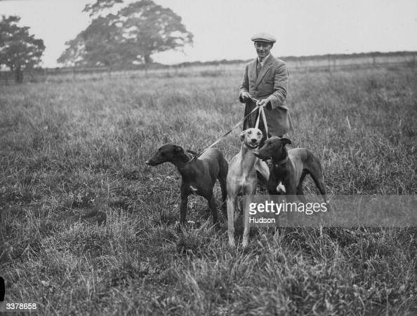 John A Dewar with three of the greyhounds he has inherited as a part of the late Lord Dewar's estate near East Grinstead