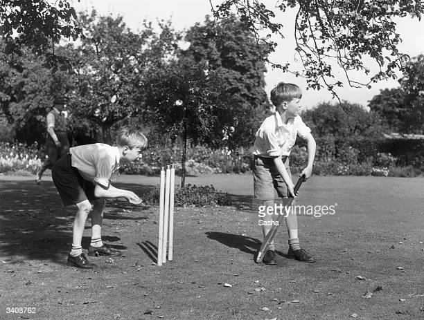 John and James Best twin sons of actress Edna Best playing cricket in the gardens of Ivor Novello's home 'Red Roofs' in Littlewick Green Maidenhead