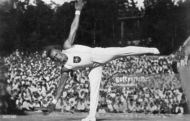 1936 Berlin Olympic allaround gymnastics champion Alfred Schwarzmann in the middle of a standing balance in the floor exercise