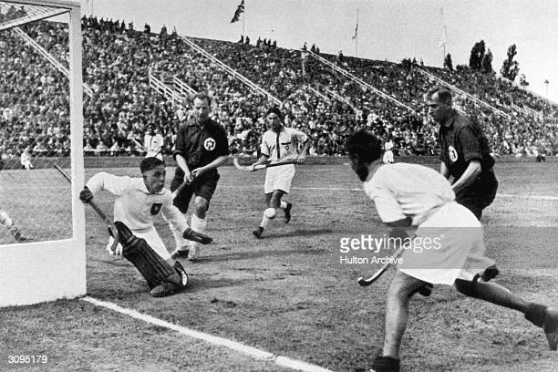 A tricky situation in front of the German goal during the Hockey Final against India at the 1936 Berlin Olympic Games India won 81