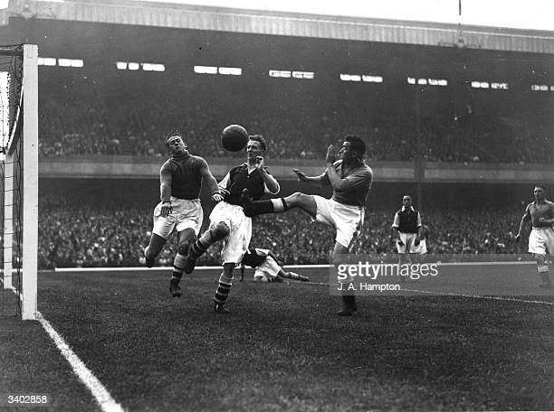 Everton forward 'Dixie' Dean launches an attack on the Arsenal goal during a match at Highbury London