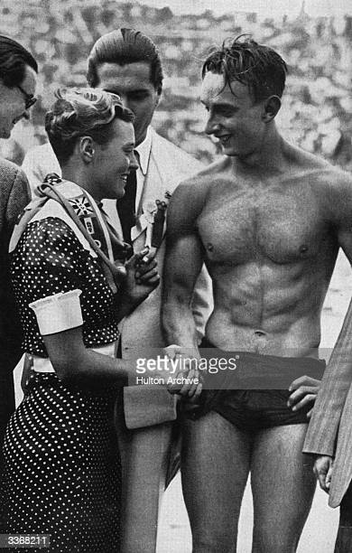 Willie den Ouden who set a World Record for 100 metre freestyle in 1936 which lasted for 20 years congratulates Ferenc Csik on winning the 100 meter...