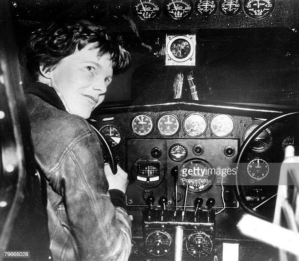 August 1937 American aviator and pilot Amelia Earhart is pictured at the controls of her aeroplane