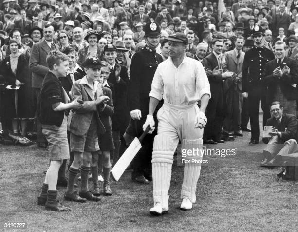 Spectators clapping Australian cricketer Sir Don Bradman as he comes out during the 4th Test Match at Headingley Leeds Sir Donald Bradman was the...