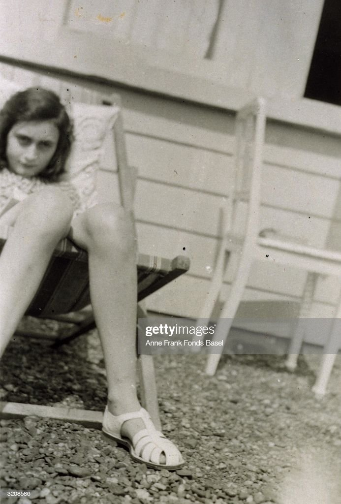 Portrait of <a gi-track='captionPersonalityLinkClicked' href=/galleries/search?phrase=Anne+Frank&family=editorial&specificpeople=173492 ng-click='$event.stopPropagation()'>Anne Frank</a> (1929 - 1945) sunbathing on her family's roof taken from her photo album, Merwedeplein, Amsterdam, Holland.