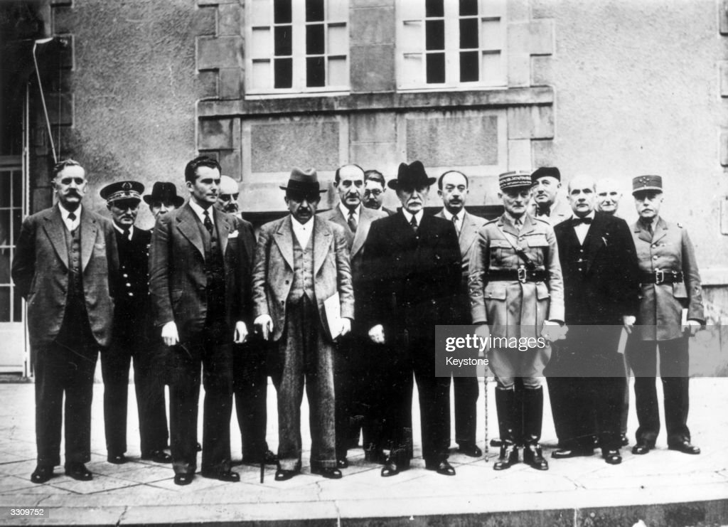 The Second French Vichy Government, on the steps in the garden of the Pavillion de Sevigne at Vichy. L-R: Front row: Pierre Caziot (Agriculture) (1876 - 1953), Admiral Jean-Francois Darlan (Navy) (1881 - 1942), Paul Baudoin (Foreign Affairs) (1894 - 1964), Raphael Alibert (Justice) (1886 - 1963), Pierre Laval (1883 - 1945), Adrien Marquet (Interior) (1884 - 1955), Marshall Henri-Philippe Petain (1856 - 1951), General Maxime Weygand (National Defense) (1867 - 1965), Henri Lemery (Colonies) (1874 - 1972). Back row: Yves Bouthillier (Finance) (1901 - 1977), Emile Mireaux (Education) (1885 - 1969), Jean Ybarnegaray (Youth and Family) (1883 - 1956), General Bertrand Pujo (Aviation) (1878 - 1964), General Louis Colson (War) (1875 - 1951).