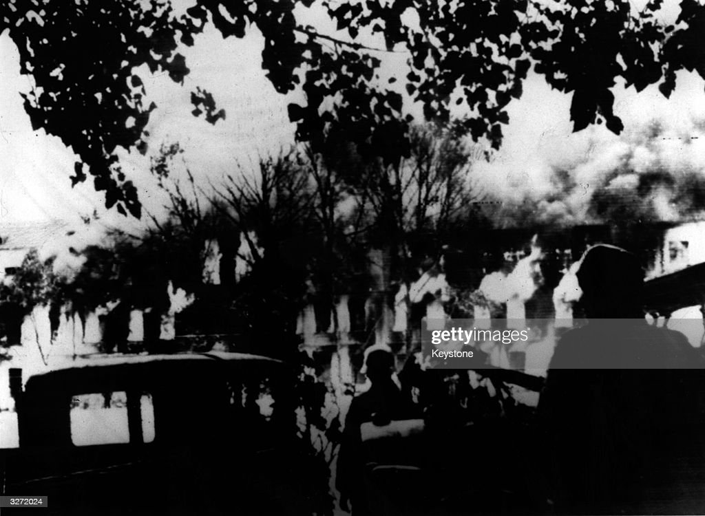 Two Nazi soldiers watch burning buildings in the city of Smolensk This picture backed up persistent German claims that Smolensk had fallen