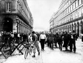 German prisoners guarded by Free French troops in the Rue de Castiglione following the liberation of Paris