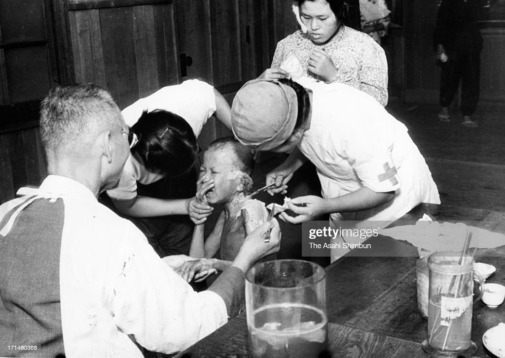 A small atomic bomb survivor cries as he receives a treatment at temporary hospital set at Shin Kozen Elementary School in August 1945 in Nagasaki, Japan. The world's first atomic bomb was dropped on Hiroshima on August 6, 1945 by the United States at the end of World War II, killing an estimated 70,000 people instantly. Three days later another atomic bomb was dropped on Nagasaki. With the effects of radiation, many thousands more dying over the following years and the number of the victims are thought to be approximately 340,000 people.