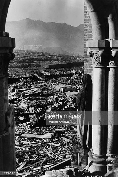 A statue standing in an archway at Urakami Catholic Cathedral looks out across the devastation towards Chinzei Mission School in the distance after...