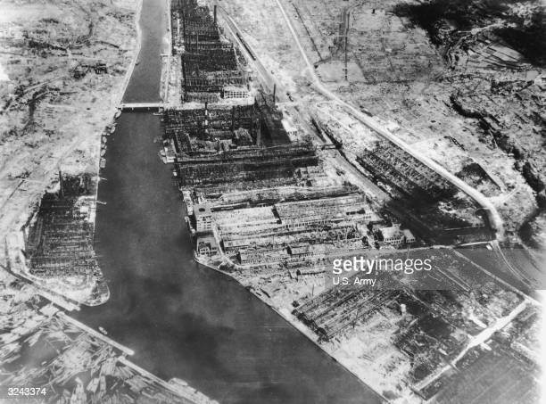 Aerial view of the stripped roofs and distorted steel frames of the Mitsubishi Steel and Arm Works after the United States dropped the second atomic...