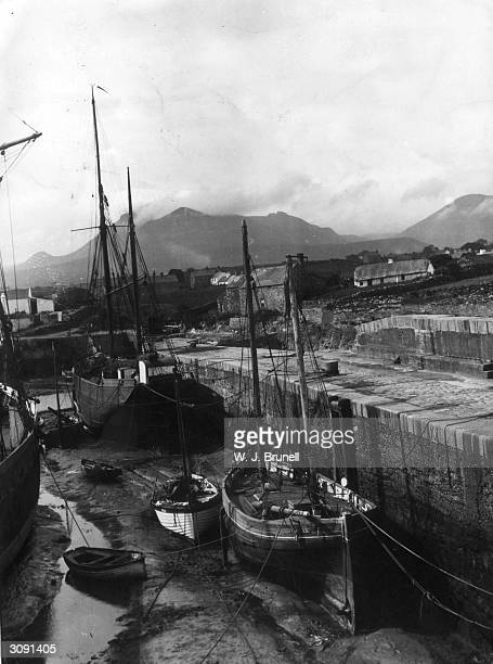 The small harbour at Annalong County Down Northern Ireland with the mountains of Mourne in the background