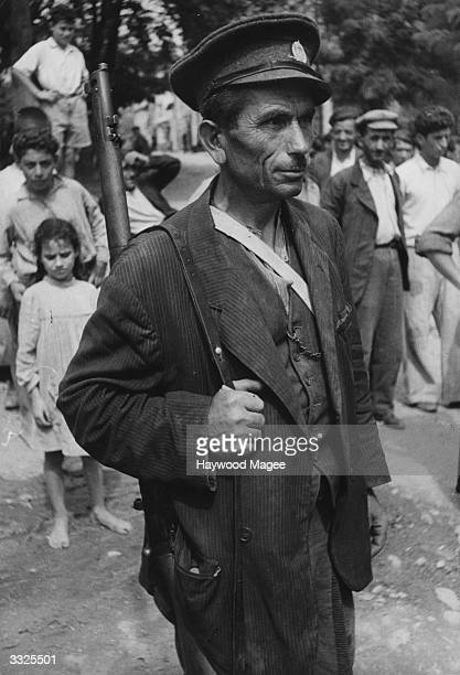 A Home Guard at Goumenissa Macedonia after an Andartes raid during the Greek Civil War Original Publication Picture Post 4500 Europe Special Food...