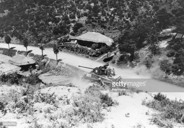 An American tank takes on a South Korean village during the Korean War