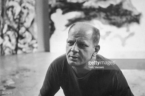 Portrait of American Abstract Expressionist painter Jackson Pollock at his studio in East Hampton New York