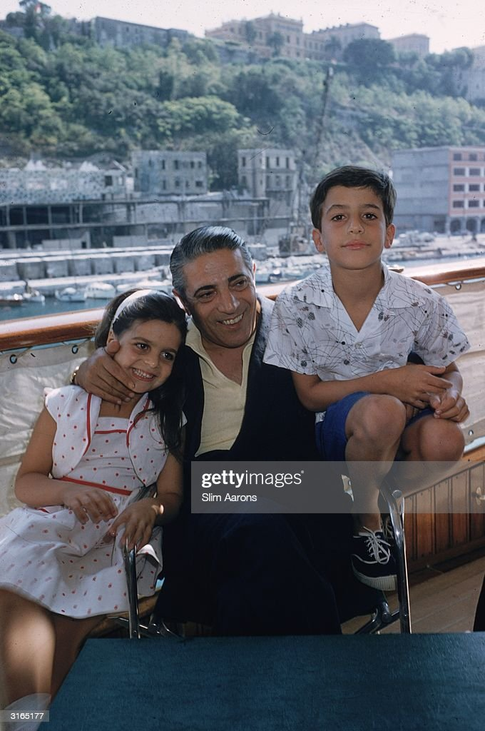 Greek shipping magnate Aristotle Onassis (1906 - 1975) with his children Christina and Alexander (1948 - 1973) on board his luxury yacht 'Christina' in Monte Carlo harbour.