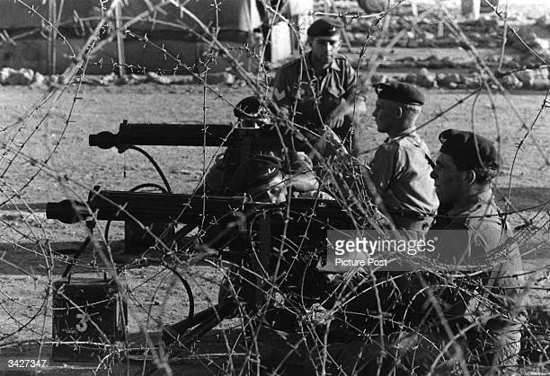 Soldiers of the 3rd Battalion of the Parachute Regiment manning artillery in Cyprus during the campaign of antiBritish violence waged by GreekCypriot...