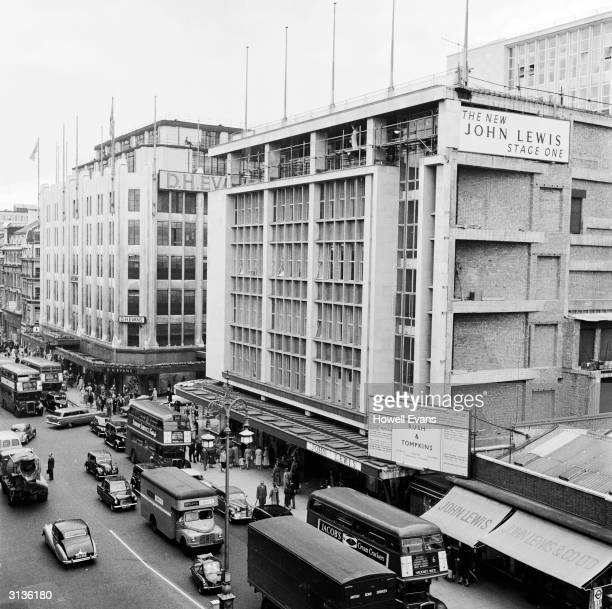 Stage one of the construction of the John Lewis department store in Oxford Street London's busy shopping district D H Evans is visible in the...