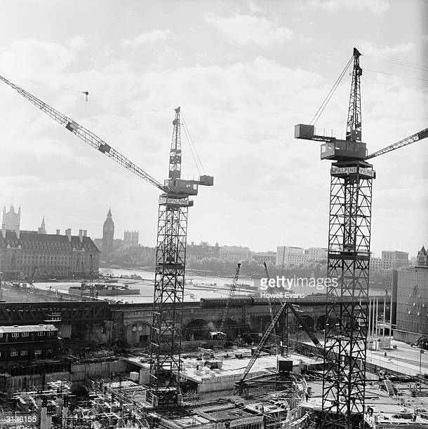 The construction of the South Bank Centre near the River Thames in London with Big Ben in the background across the river