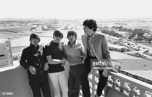 British pop group The Beatles on a hotel balcony during their tour of America