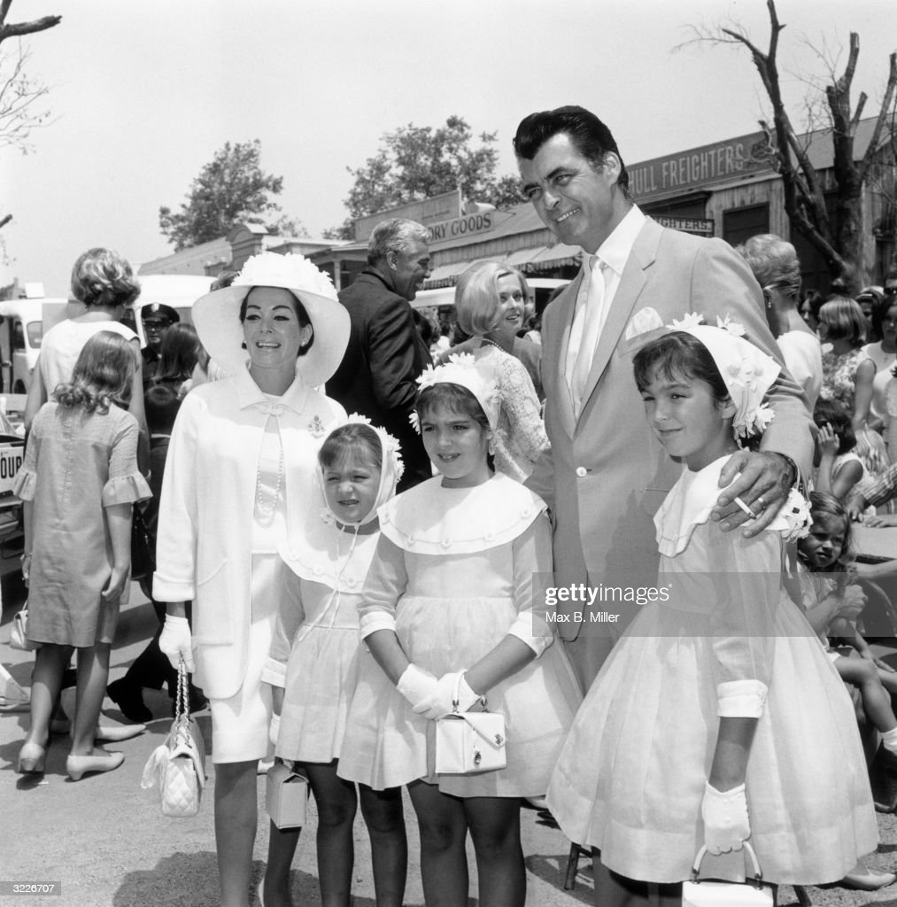 American actor Rory Calhoun and his wife Lita Baron with their three daughters at a children's party a 'Batman' luncheon for an orphanage in...